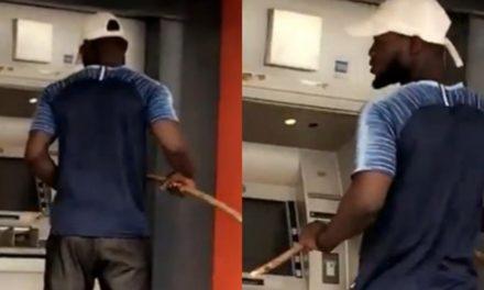 Coronavirus: Man operates ATM with stick