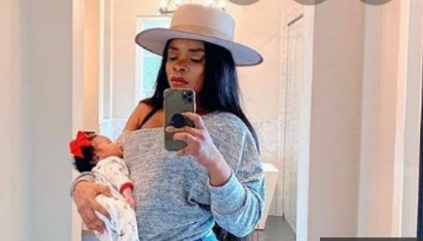 Laura Ikeji steps out with her 8 day old baby to resume work (Pictures)