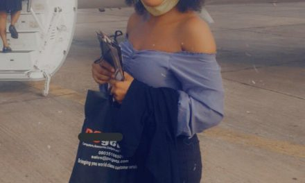 Nigerian lady celebrates entering plane for the first time in her life