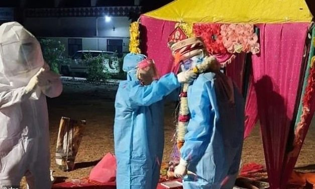 Couple marries in full protective gear at isolation center after bride tests positive for COVID-19